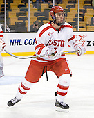 Adam Clendening (BU - 4) - The Harvard University Crimson defeated the Boston University Terriers 5-4 in the 2011 Beanpot consolation game on Monday, February 14, 2011, at TD Garden in Boston, Massachusetts.