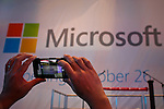A man takes pictures with his android during the opening of Microsoft's store at Times Square in New York, October 25, 2012. . Photo by Eduardo Munoz Alvarez / VIEW.