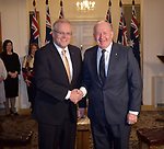 Australian Prime Minister Scott Morrison (L) is sworn in by Governor General Peter Cosgrove (R) at Government House, Canberra, Wednesday May 29, 2019. AFP PHOTO/ MARK GRAHAM