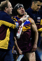 AFL preliminary final Brisbane v Geelong at the MCG  18/9/04   Shaun Hart is helped off the ground after recieving facial injuries in a clash with team-mate Daniel Bradshaw. - pic by Trevor Collens