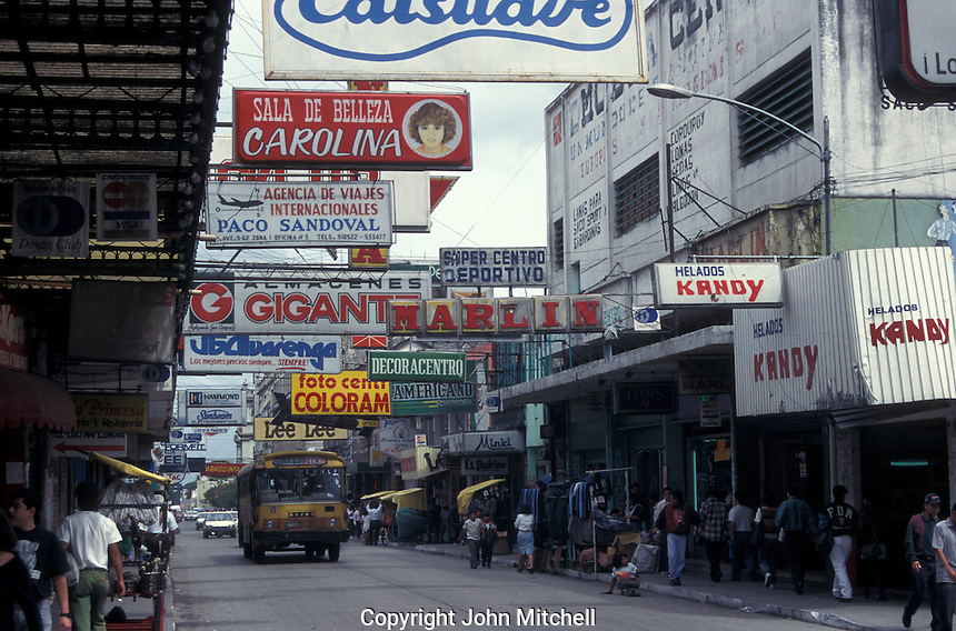 Signs overhanging a street in downtown Guatemala City, Guatemala