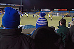Macclesfield Town 0 Gateshead 4, 22/02/2013. Moss Rose, Football Conference. A woman in a blue bobble hat watching the early action as Macclesfield Town (in blue) host Gateshead at Moss Rose in a Conference National fixture. The visitors from the North East who were in the relegation zone, shocked Macclesfield with four first half goals and won 4-0 in front of 1467 fans. Both teams were former members of the Football league, with Macclesfield dropping out in 2012. Photo by Colin McPherson.