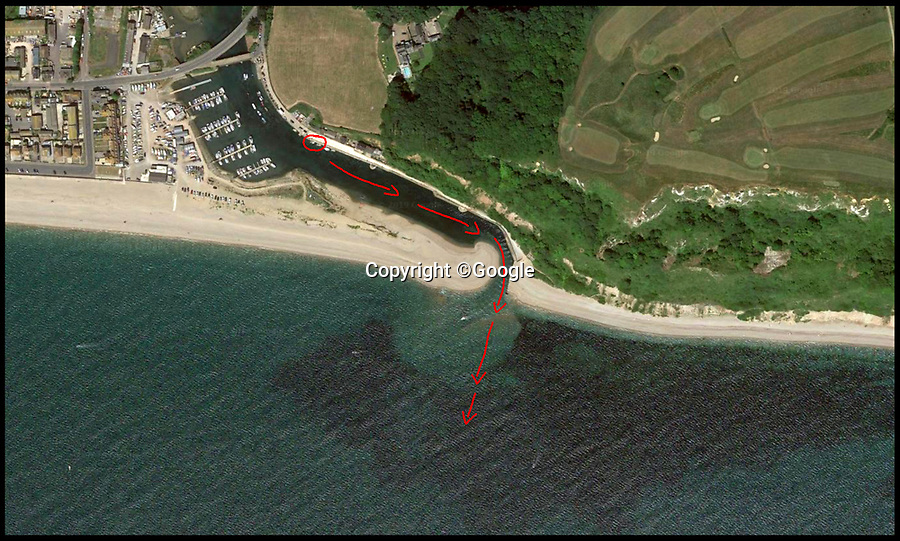 BNPS.co.uk (01202 558833)<br /> Pic :  Google<br /> <br /> Google Maps view showing the area (circled) the boys first entered the water, and were then swept out to sea.<br /> <br /> This is the dramatic moment two teenage tombstoners were saved from drowning after they were swept 250 yards out to sea.<br /> <br /> Archie Woollacott, 14, got dragged away by a strong current after plunging off a harbour wall at Axmouth, Devon. His friend Bozhidrar Bobev jumped in to rescue him but was also taken out to sea.<br /> <br /> The stricken pair spent an hour treading water before they were spotted by the Lyme Regis lifeboat crew in the nick of time.<br /> <br /> The next day Archie visited to RNLI station to thank the crew by baking them a lemon drizzle cake.