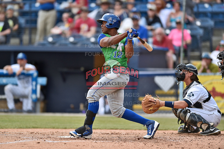 Lexington Legends right fielder Elier Hernandez (12) swings at a pitch during a game against the Asheville Tourists on May 3, 2015 in Asheville, North Carolina. The Legends defeated the Tourists 6-3. (Tony Farlow/Four Seam Images)