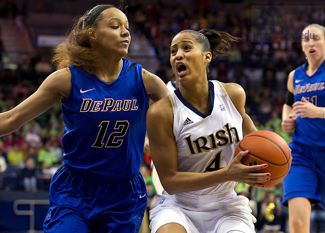 February 5, 2012; Skylar Diggins drives to the net past DePaul guard Brittany Hrynko during the second half. Notre Dame won 90-70. Photo by Barbara Johnston/University of Notre Dame