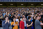 Wolves supporters applauding their team at St. Andrew's stadium, at the final whistle of Birmingham City's Barclay's Premier League match with Wolverhampton Wanderers. Both clubs were battling against relegation from  England's top division. The match ended in a 1-1 draw, watched by a crowd of 26,027.