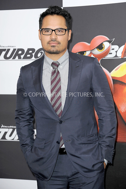 WWW.ACEPIXS.COM<br /> July 9, 2013...New York City <br /> <br /> Michael Pena attending the DreamWorks Animation, in Association with 20th Century Fox Premiere of TURBO<br /> at AMC Loews Lincoln Square, New York, NY on July 9, 2013.<br /> <br /> Please byline: Kristin Callahan... ACE<br /> Ace Pictures, Inc: ..tel: (212) 243 8787 or (646) 769 0430..e-mail: info@acepixs.com..web: http://www.acepixs.com