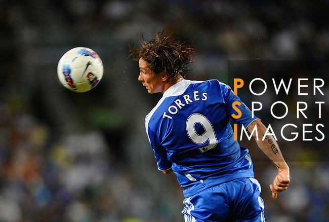 SO KON PO, HONG KONG - JULY 30: Fernando Torres of Chelsea heads the ball during the Asia Trophy Final match against Aston Villa at the Hong Kong Stadium on July 30, 2011 in So Kon Po, Hong Kong.  Photo by Victor Fraile / The Power of Sport Images