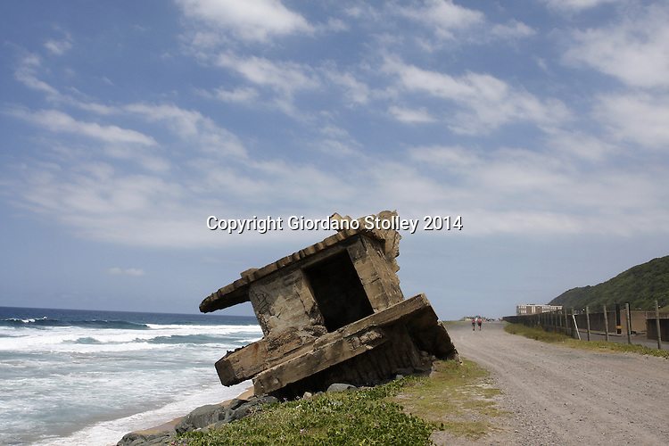DURBAN - 9 February 2011 - Along Durban's Bluff coastline these watch towers were placed during World War II and manned with soldiers to guard against enemy landing and to keep an eye on suspicious behaviour. Few remain, but this one near the city's old whaling station is slowly toppling over as mother nature takes charge. Picture: Allied Picture Press/APP