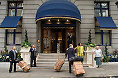 Porters carry luggage outside the Ritz Hotel in Picadilly, London