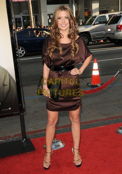 "AUDRINA PATRIDGE.The Warner Brother Pictures' L.A. Premiere of ""The Hangover"" held at The Grauman's Chinese Theatre in Hollywood, California, USA. .June 2nd, 2009.half length brown silk satin dress black belt clutch bag hand on hip.CAP/DVS.©Debbie VanStory/Capital Pictures."