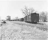 View of D&amp;RGW Farmington yard with string of box cars on siding near water tank.  Abandonment is underway.  The last revenue trains ran in August, 1968 and the depot is missing.<br /> D&amp;RGW  Farmington, NM  Taken by McCarter, M. D. - 3/22/1969