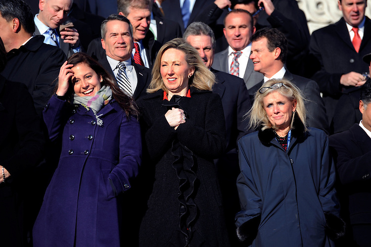 UNITED STATES - NOVEMBER 18: From left, Rep.-elects Elise Stefanik, R-N.Y., Barbara Comstock, R-Va., and Debbie Dingell, D-Mich., gather on the House Steps of the Capitol for the 114th Congress's freshman class photo, November 18, 2014. (Photo By Tom Williams/CQ Roll Call)
