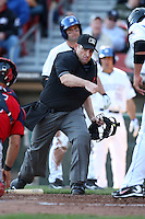 April 14, 2010:  Home plate umpire Johnny Conrad calls out a base runner during a game at Coca-Cola Field in Buffalo, New York.  Photo By Mike Janes/Four Seam Images