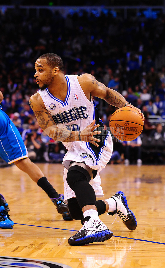Feb. 11, 2011; Orlando, FL, USA; Orlando Magic guard (14) Jameer Nelson against the New Orleans Hornets at the Amway Center. The Hornets defeated the Magic 99-93. Mandatory Credit: Mark J. Rebilas-