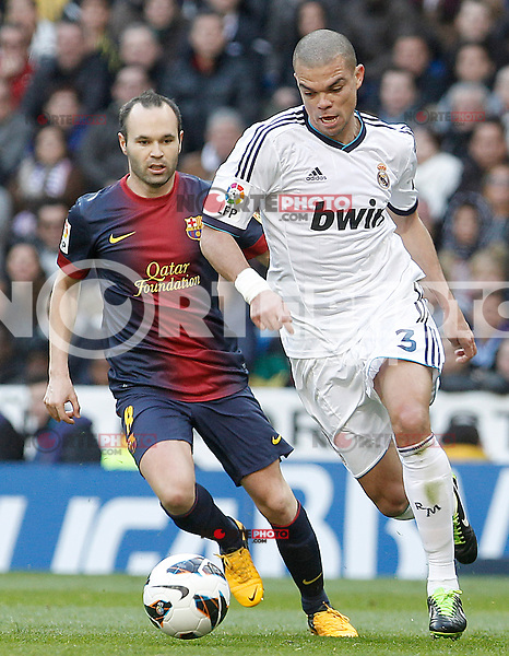 Real Madrid's Pepe (r) and FC Barcelona's Andres Iniesta during La Liga match.March 02,2013. (ALTERPHOTOS/Acero) /NortePhoto