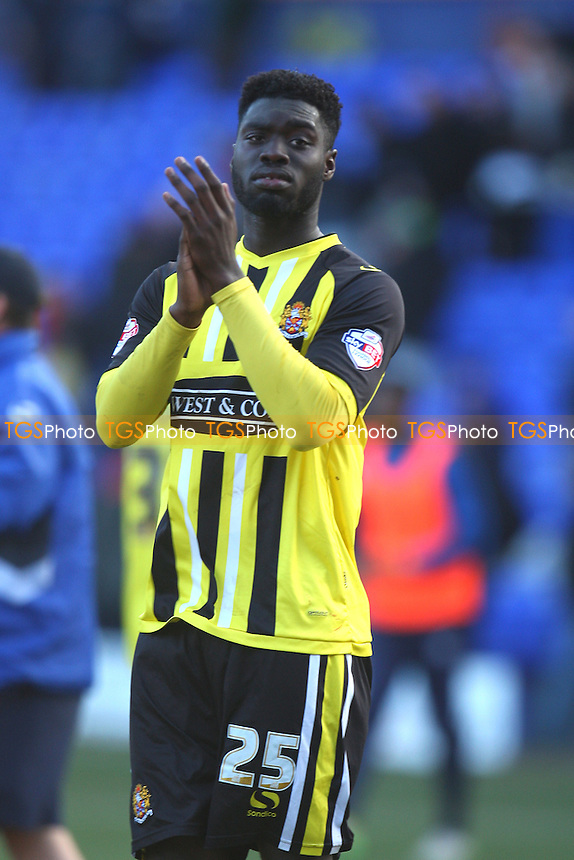 Ayo Obileye of Dagenham and Redbridge applauds the fans at the end of the game - Tranmere Rovers vs Dagenham and Redbridge - SkyBet League Two football at the Prenton Park Stadium on  07/03/15 - MANDATORY CREDIT: Dave Simpson/TGSPHOTO - Self billing applies where appropriate - 0845 094 6026 - contact@tgsphoto.co.uk - NO UNPAID USE