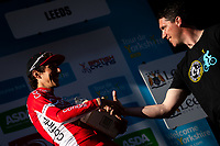 Picture by Alex Whitehead/SWpix.com - 05/05/2018 - Cycling - 2018 Tour de Yorkshire - Stage 4: Halifax to Leeds - Stage winner Stephane Rossetto of Team COFIDIS with the Black Sheep beer prize.