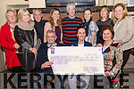 The Ashe family presenting a cheque for 37,008.11 euro from the raffle ticket sale of a Belgian Blue in-calf Heifer to the Kerry Hospice Foundation at Brosnan's Pub in Annascaul on Firday night. F-l: Ted Moynihan (Kerry Hospice), Geraldine Ashe, Mary Shanahan (Kerry Hospice). B-l: Kathleen O'Connor, Ursula O'Connell, Dr. Tom McCormack, Grainne Ashe, Gerard Ashe, Deirdre Ashe, Linda O'Connor and Andrea O'Donoghue.