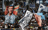 Calcio, Serie A: Lazio vs Palermo. Roma, stadio Olimpico, 2 settembre 2012..Lazio fans wave flags portraying British former Lazio player Paul Gascoigne, left, and past actress Elena Fabrizi, better known as Sora Lella, right, prior to the start of the Italian Serie A football match between Lazio and Palermo at Rome's Olympic stadium, 2 September 2012..UPDATE IMAGES PRESS/Riccardo De Luca