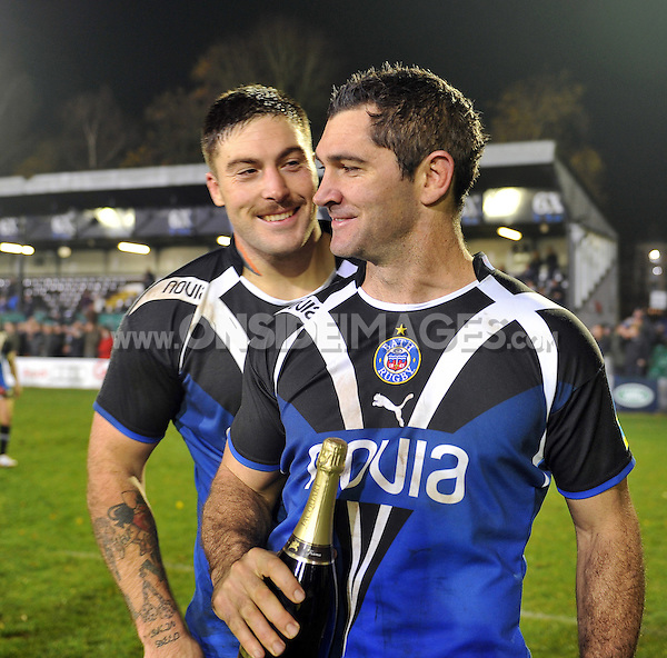 Matt Banahan and Man of the Match Stephen Donald after the final whistle. Aviva Premiership match, between Bath Rugby and Harlequins on November 23, 2012 at the Recreation Ground in Bath, England. Photo by: Patrick Khachfe / Onside Images