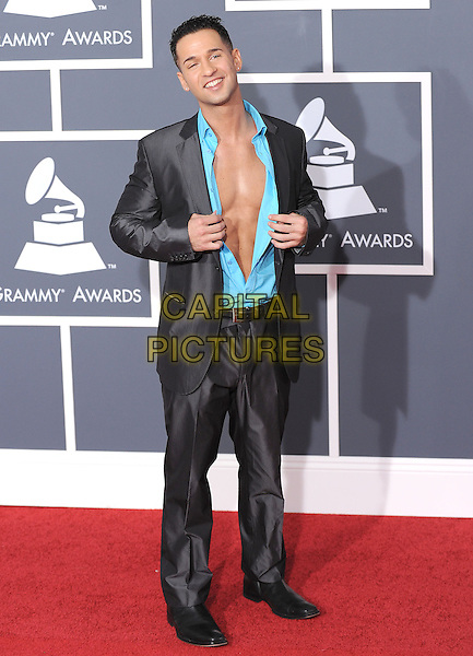 MIKE 'The Situation' SORRENTINO.Arrivals at the 52nd Annual GRAMMY Awards held at The Staples Center in Los Angeles, California, USA..January 31st, 2010.grammys full length grey gray suit open unbuttoned shirt teal blue hands chest .CAP/RKE/DVS.©DVS/RockinExposures/Capital Pictures