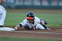 Branden Cogswell #7 of the Virginia Cavaliers dives back into first base during Game 4 of the 2014 Men's College World Series between the Virginia Cavaliers and Ole Miss Rebels at TD Ameritrade Park on June 15, 2014 in Omaha, Nebraska. (Brace Hemmelgarn/Four Seam Images)