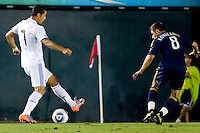 Dema Kovalenko of the LA Galaxy watches the ball and quick moving feet of Cristiano Ronaldo of Real Madrid as he moves with the ball. Real Madrid beat the LA Galaxy 3-2 in an international friendly match at the Rose Bowl in Pasadena, California on Saturday evening August 7, 2010.