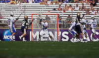 Dan Wigrizer (19) of Duke saves a shot during the NCAA Men's Lacrosse Championship held at M&T Stadium in Baltimore, MD.  Duke defeated Notre Dame, 6-5, to win the title in overtime.