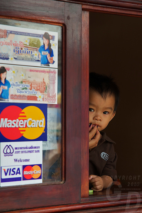 Boy at a shop Window Luang Prabang,Laos