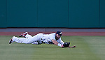 Reno Aces center fielder Adam Eaton makes the diving catch agianst the Albuquerque Isotopes during their game on Friday night August 10, 2012 at Aces Ballpark in Reno NV.