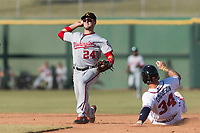 Salt River Rafters second baseman Carter Kieboom (24), of the Washington Nationals organization, throws to first base to try to complete a double play as Braxton Davidson (34) slides into second base during the Arizona Fall League Championship Game against the Peoria Javelinas at Scottsdale Stadium on November 17, 2018 in Scottsdale, Arizona. Peoria defeated Salt River 3-2 in 10 innings. (Zachary Lucy/Four Seam Images)