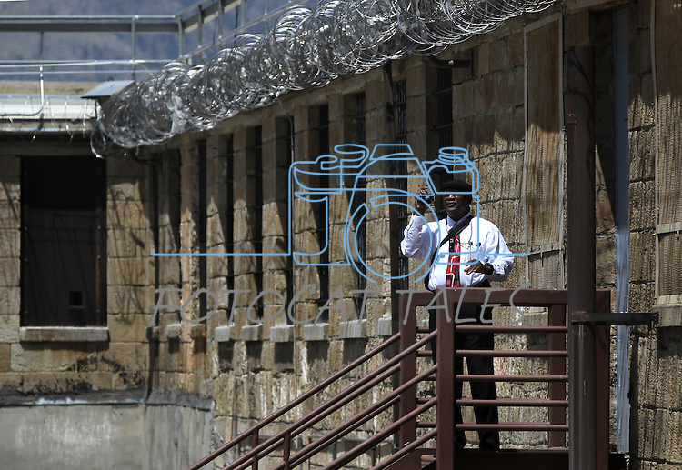 An unidenfied man takes pictures of the yard at the 150-year-old Nevada State Prison in Carson City, Nev., following a decommissioning ceremony Friday, May 18, 2012. .Photo by Cathleen Allison