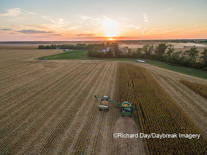 63801-08309 Corn Harvest, John Deere combine unloading corn into grain cart while harvesting - aerial Marion Co. IL