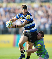 Matt Banahan of Bath Rugby looks to offload the ball after being tackled by Jon Welsh of Newcastle Falcons. Aviva Premiership match, between Bath Rugby and Newcastle Falcons on September 23, 2017 at the Recreation Ground in Bath, England. Photo by: Patrick Khachfe / Onside Images