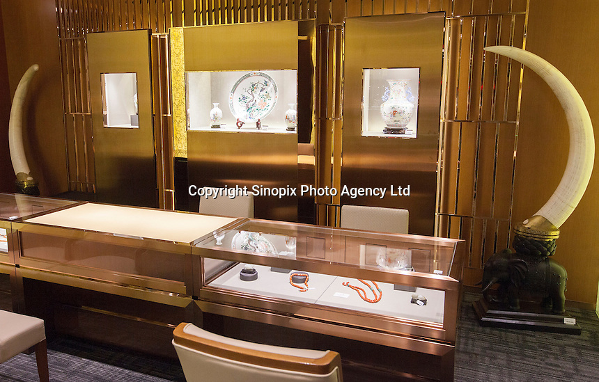 A pair of ivory tusks worth HK$8.2 million (GBP648,000.00) on sale in 'Chinese Arts & Crafts', Hong Kong, China, 29 November 2013. <br /> <br /> Photo by Alex Hofford / Sinopix
