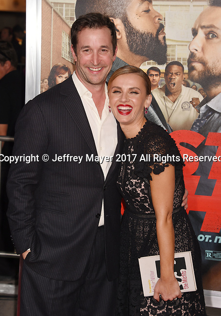 HOLLYWOOD, CA - FEBRUARY 13: Actors Noah Wyle (L) and Sara Wells attend the premiere of Warner Bros. Pictures' 'Fist Fight' at the Regency Village Theatre on February 13, 2017 in Westwood, California.