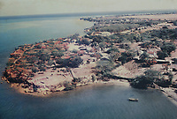 Aerial photograph of La Isabela from the 1960s, before its erosion by the sea, showing the original walls surrounding the Casa del Almirante, in the museum, or Museo de la Isabela, in the Parque Nacional Historico y Arqueologico de La Isabela, or Historical National Park of La Isabela, one of the oldest European settlements in the New World, in Luperon province, on the North coast of the Dominican Republic, in the Caribbean. The town of La Isabela was founded in 1493 by Christopher Columbus and a fort, houses, church, warehouses, and an arsenal were built, but the settlement was abandoned in 1496 due to hurricane damage. Picture by Manuel Cohen