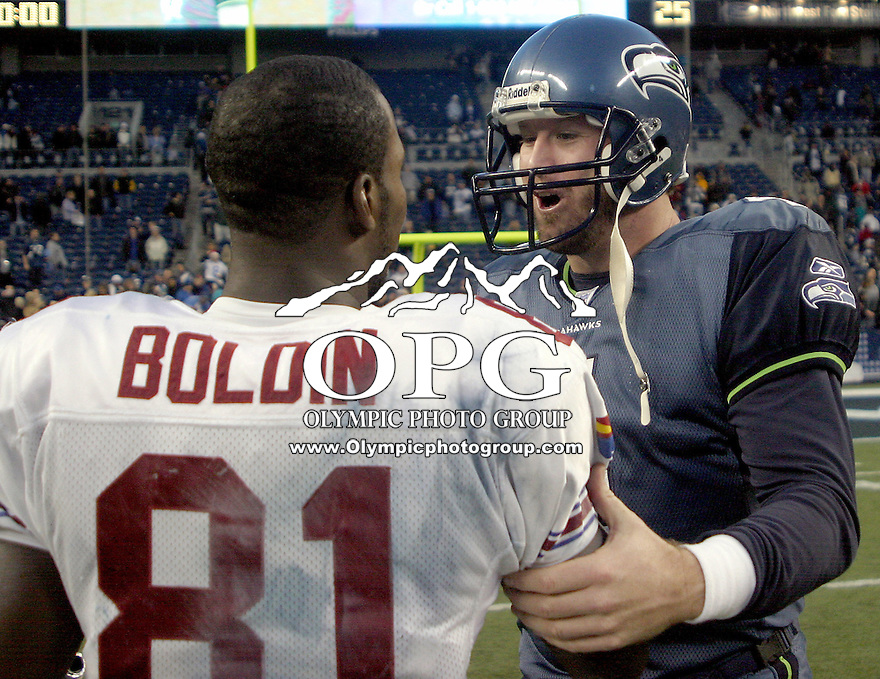 December 21, 2003: Seattle Seahawks quarterback Trent Dilfer complemented  Arizona Cardinals rookie wide receiver Anquan Boldin for his break out season and told him he was going to the Pro Bowl at Quest field in Seattle, WA.