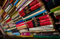 Spines of used books are seen stacked in a secondhand bookshop in San Salvador, El Salvador, 12 April 2018. Large collections of worn-out books, mostly textbooks and educational paperbacks, are sold regularly in secondhand bookshops in the center of the city.