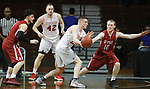 SIOUX FALLS, SD - MARCH 9:  Kyle Mangas #24 of Indiana Wesleyan passes around the defense of Jared Osborne #10 at the 2018 NAIA DII Men's Basketball Championship at the Sanford Pentagon in Sioux Falls. (Photo by Dick Carlson/Inertia)