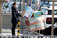 Since last night, long lines have formed out of the supermarkets, due to the restriction that allows few people at a time inside. Many people went panic and were stripping shelves of staples like toilet paper and pasta for a few weeks.<br /> Rome March 10th 2020. Rome the day after the last Minister Council's decree, that extends the restrictions from North of Italy to the entire country to contain Covid-19 Virus. All the shops (restaurants, pubs, and even supermarkets) will have to close at 6 pm. Gathering of people will be forbitten and people will have to maintain the 1 meter security distance. Citizens are furthermore invited to stay at home with the exception of people who have to go to work, to the pharmacy or to the supermarket.<br /> Photo Samantha Zucchi Insidefoto