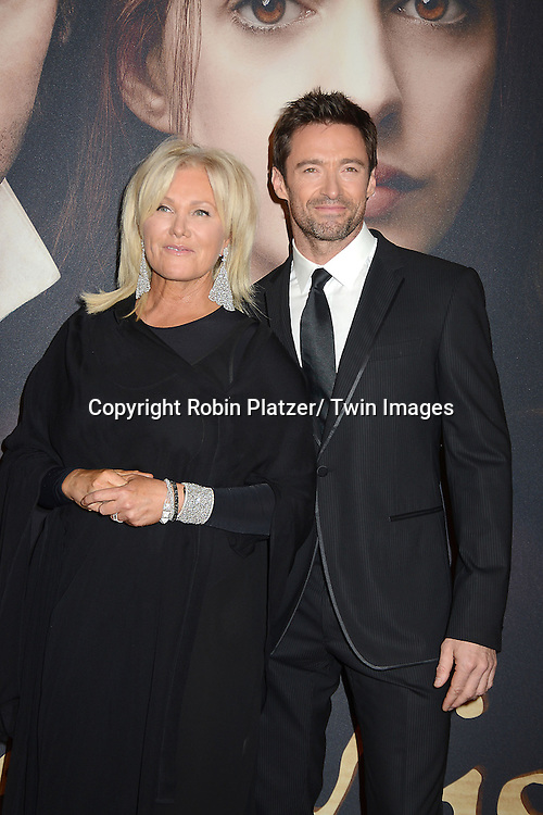 """Hugh Jackman and wife Deborra-Lee Furness  attends the American Premiere of """"Les Miserables"""" on December 10, 2012 at the Ziegfeld Theatre in New York City. The movie stars Hugh Jackman, Anne Hathaway, Amanda Seyfried, Eddie Redmayne, Russell Crowe, Samantha Barks, Isabelle Allen and Sacha Baron Cohen."""
