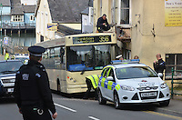 Pictured: The bus which collided with a building window in Darklin, Pembroke, west Wales. Wednesday 26 March 2014<br />