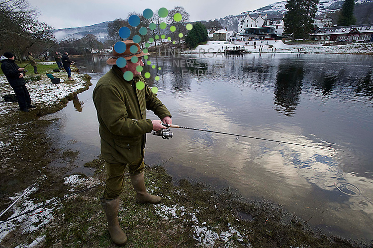 .Fishermen parade to the banks of the Tay at Kenmore to cast te first fly, a tradtional opening ceremony of the fishing season held since 1947, followed by a day salmon fishing, Kenmore, Scotland, 15th January, 2013  .Picture:Scott Taylor Universal News And Sport (Europe) .All pictures must be credited to www.universalnewsandsport.com. (Office)0844 884 51 22.