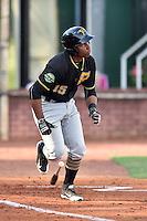 Bristol Pirates third baseman Julio De La Cruz (15) runs to first base during a game against the Elizabethton Twins at Joe O'Brien Field on July 30, 2016 in Elizabethton, Tennessee. The Twins defeated the Pirates 6-3. (Tony Farlow/Four Seam Images)