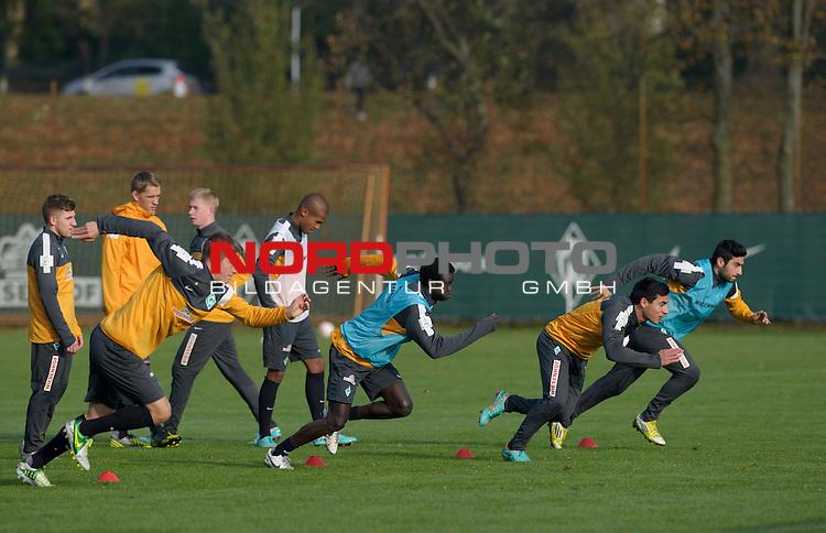 31.10.2012, Trainingsgelaende, Bremen, GER, 1.FBL, Training Werder Bremen, im Bild Johannes Wurtz (Bremen #27), Mor Pouye (Bremen #39), &Ouml;zkan / Oezkan Yildirim (Bremen #32), Mehmet Ekici (Bremen #10)<br /> <br /> // during training session of Werder Bremen on 2012/10/31, Trainingsgelaende, Bremen, Germany.<br /> Foto &copy; nph / Frisch *** Local Caption ***