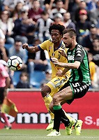 Calcio, Serie A: Reggio Emilia, Mapei stadium, 17 settembre 2017.<br /> Juventus' Juan Cuadrado (l) in action with Sassuolo's Francesco Acerbi (r) during the Italian Serie A football match between Sassuolo and Juventus at Reggio Emilia's Mapei stadium, September 17, 2017.<br /> UPDATE IMAGES PRESS/Isabella Bonotto