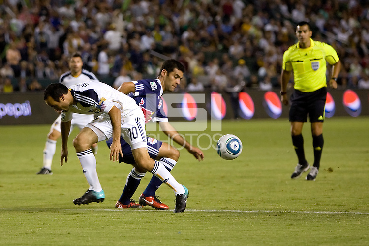 Midfielder of the LA Galaxy Landon Donovan and New York Red Bulls midfielder Rafael Marquez battle for a loose ball. LA The New York Red Bulls beat the LA Galaxy 2-0 at Home Depot Center stadium in Carson, California on Friday September 24, 2010.