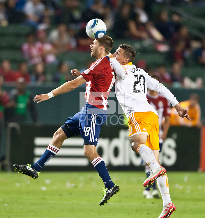 CARSON, CA – July 23, 2011: Chivas USA midfielder Blair Gavin (18) and Houston Dynamo midfielder Geoff Cameron (20) during the match between Chivas USA and Houston Dynamo at the Home Depot Center in Carson, California. Final score Chivas USA 3, Houston Dynamo 0.